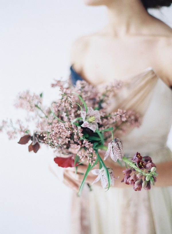 Bride holding bridal bouquet with blush flowers