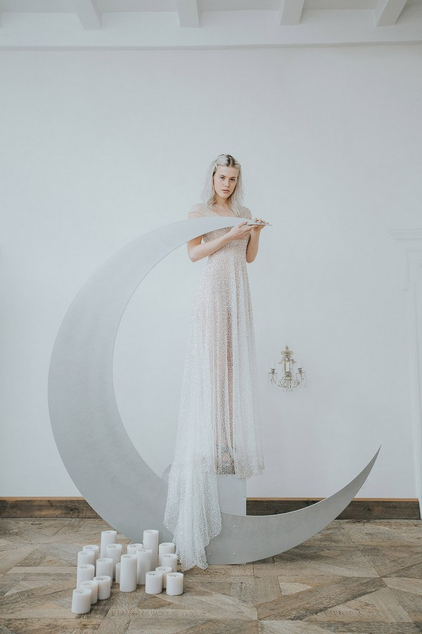 Bride standing on crescent moon