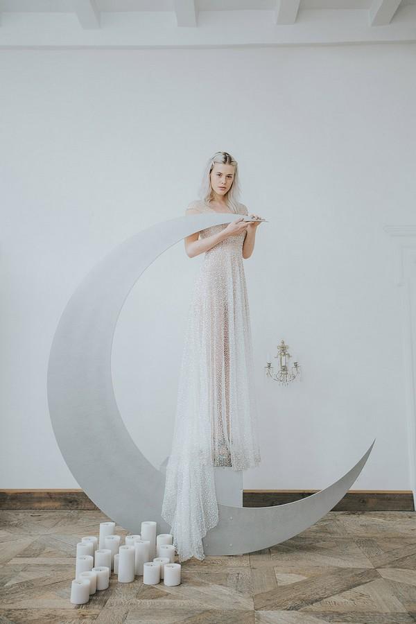 Bride standing on crescent moon