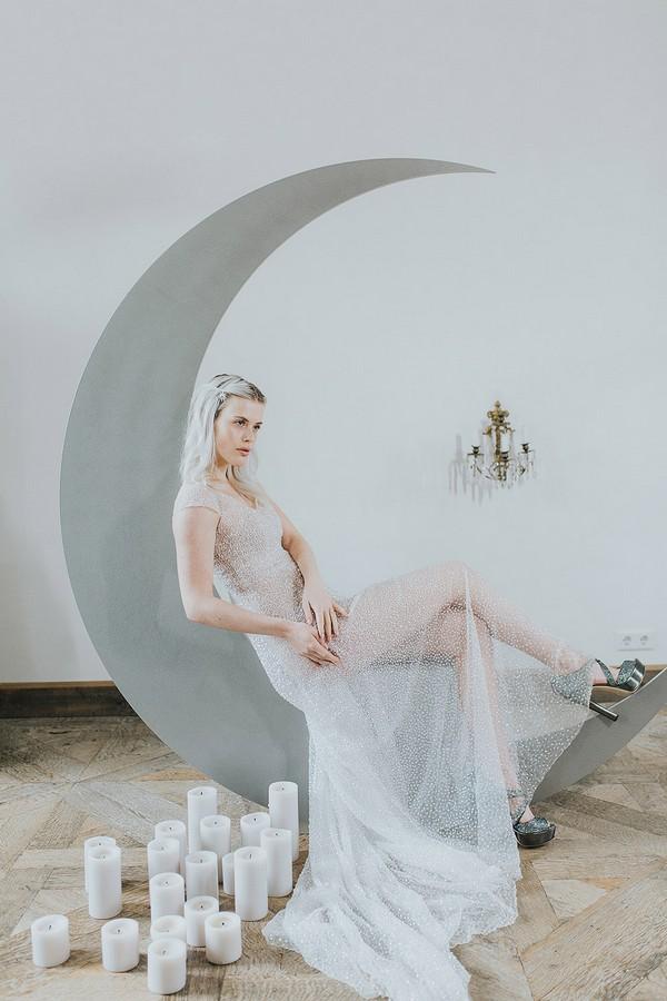 Bride sitting on crescent moon