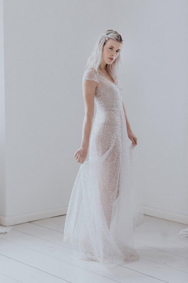Bride wearing long sparkly wedding dress