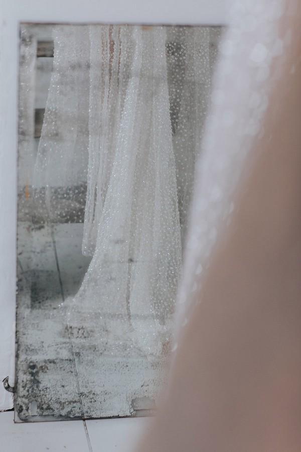 Reflection in mirror of bride's wedding dress