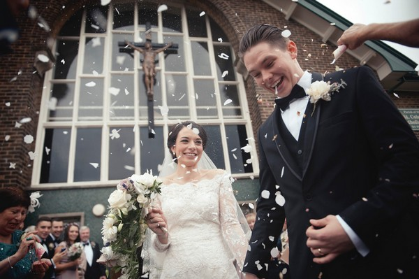 Bride and groom in confetti shower - Picture by Bethany Lloyd-Clarke Photography