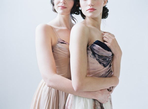 Two brides wearing blush wedding dresses