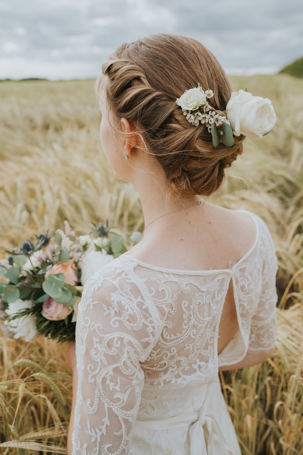 Back view of bride showing updo hairstyle and back of dress