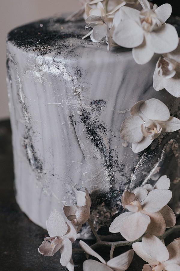 Glitter detail and flowers on celestial wedding cake