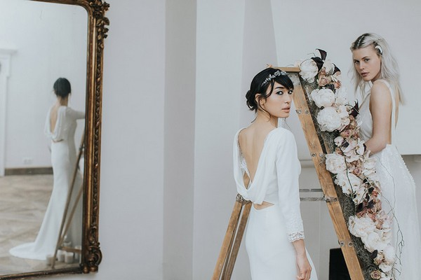 Brides on ladder covered in flowers