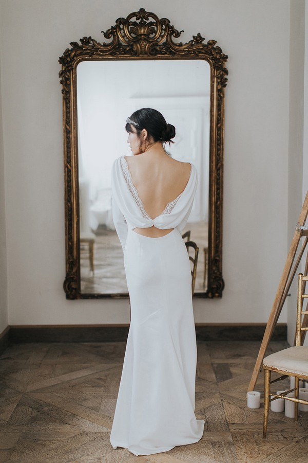 Back of bride showing cowl back of wedding dress