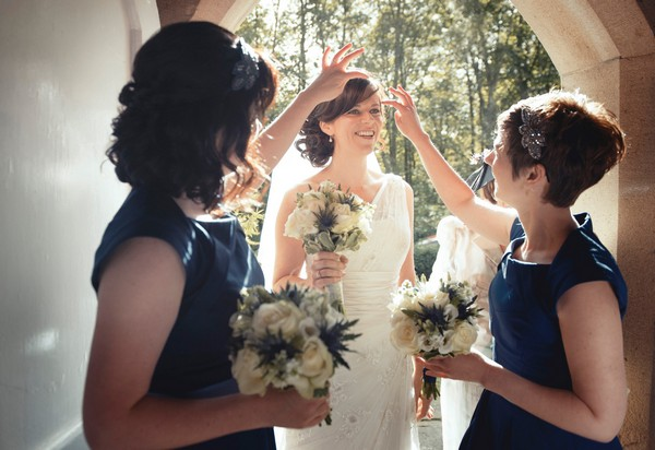 Bridesmaids moving hair from bride's face - Picture by Bethany Lloyd-Clarke Photography