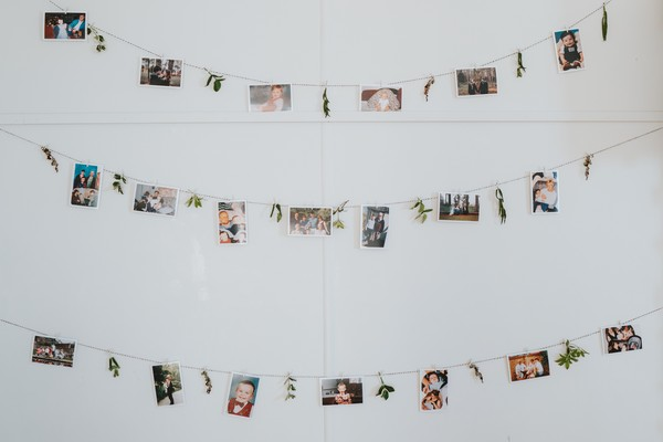 Photographs hanging from string