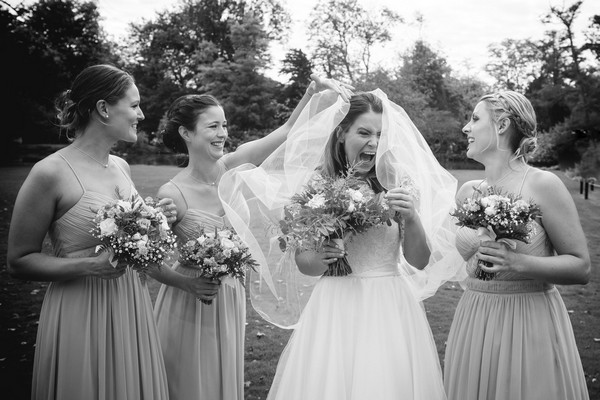 Bride laughing with bridesmaids - Picture by Bethany Lloyd-Clarke Photography