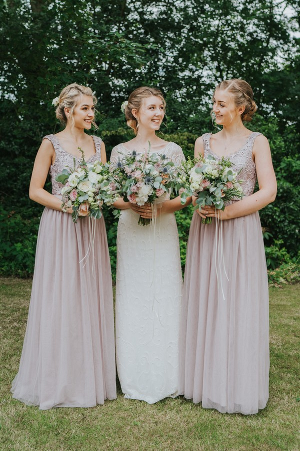 Bride and her two bridesmaids holding bouquets