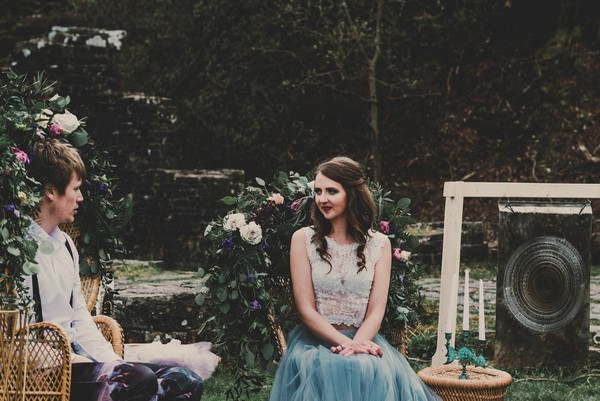 Bride sitting in outdoor seating area