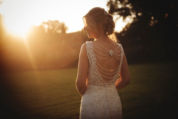 Beaded detail on back of bride's wedding dress - Picture by Bethany Lloyd-Clarke Photography