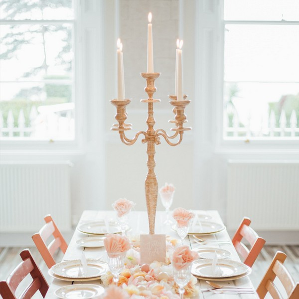 Cream and gold candelabra available to hire from from The Prop Factory