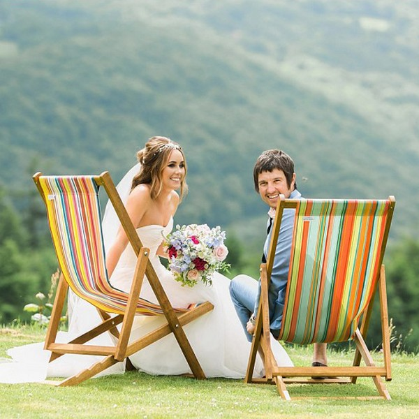 Bride and groom sitting on deckchairs available to hire from from The Prop Factory
