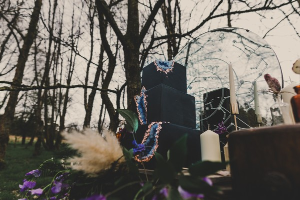 Black wedding cake with blue cut out geode detail