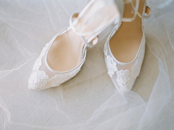 Lace flower detail on bridal shoes