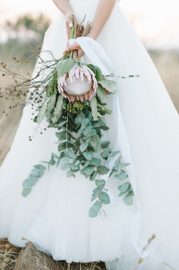 Bridal bouquet with large flower and lots of foliage