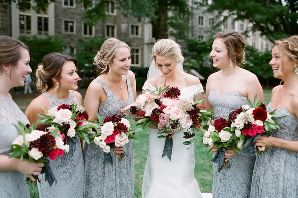 Bride with bridesmaids wearing blue grey dresses