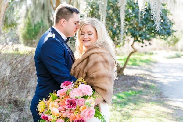 Groom resting head on bride wearing fur shrug