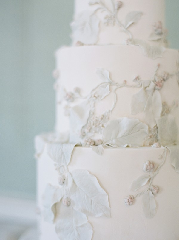 Leaf detail on white wedding cake