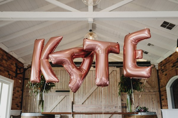 Balloons spelling out KATE
