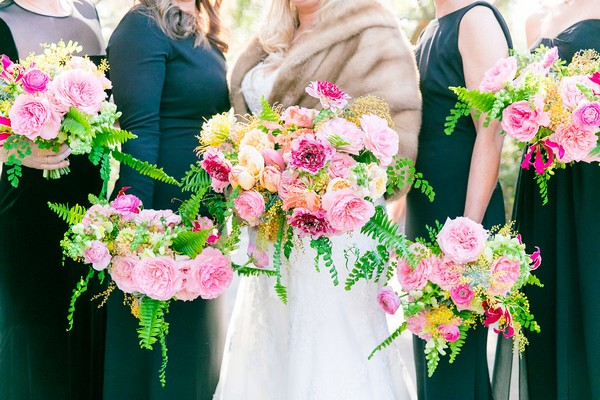 Bride and bridesmaids bright, colourful bouquets