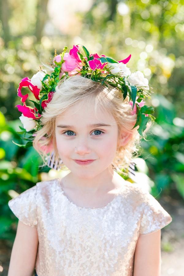 Flower girl wearing bright floral crown