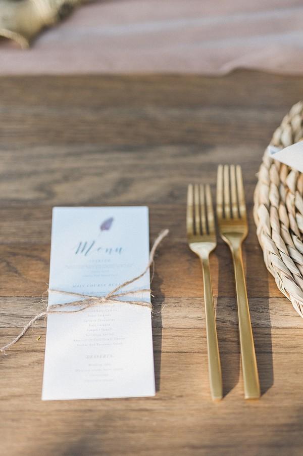 Wedding menu and gold cutlery