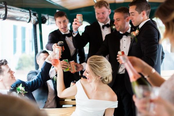 Bridal party toasting on bus