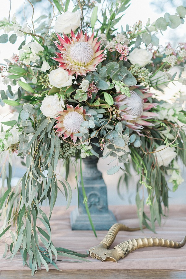 Wedding table display of large flowers and foliage