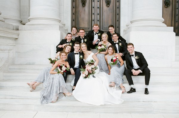 Bridal party sitting on steps of DAR, Washington
