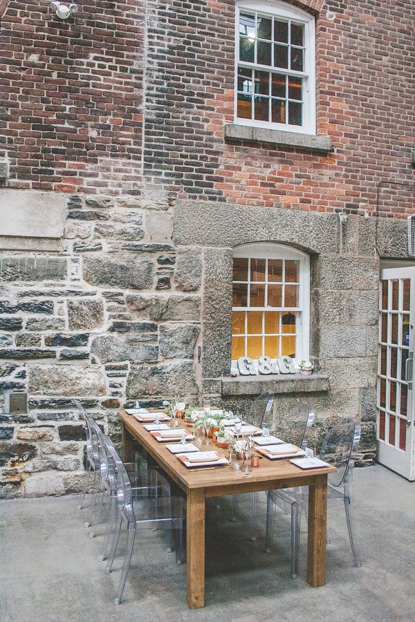 Wooden wedding table in courtyard