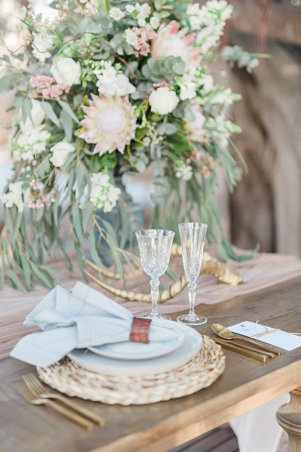 Wedding place setting with large floral display
