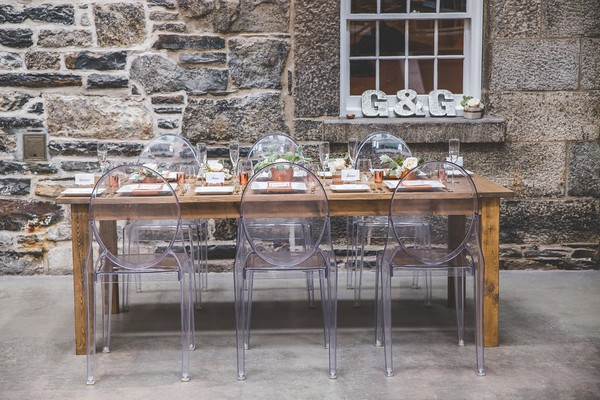 Wooden wedding table with ghost chairs