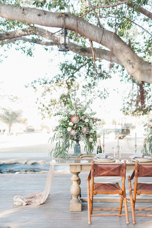 Small wedding table under tree at Nambiti Private Game Reserve
