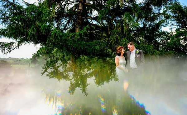 Distorted picture of bride and groomin front of tree - Picture by Lisa Carpenter Photography