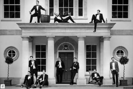 Groomsmen posing at entrance to wedding venue - Picture by Alex Beckett Photography