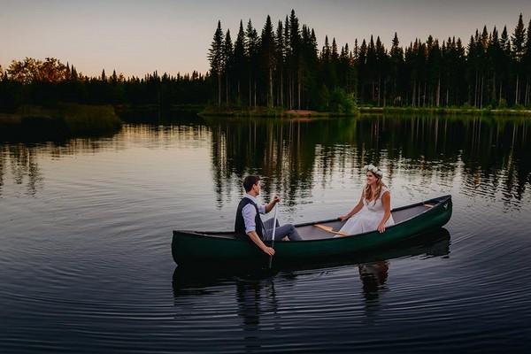 Bride and groom in rowing boat on lake - Steve Gerrard Photography