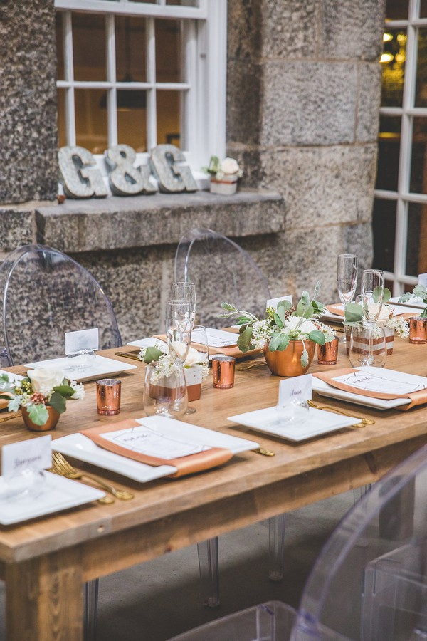 Wooden wedding table with copper styling
