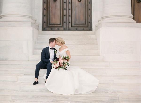 Bride and groom sitting on steps of DAR, Washington
