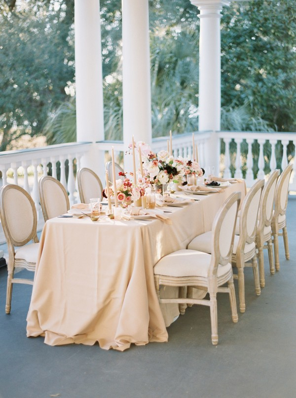 Wedding table with peach tablecloth