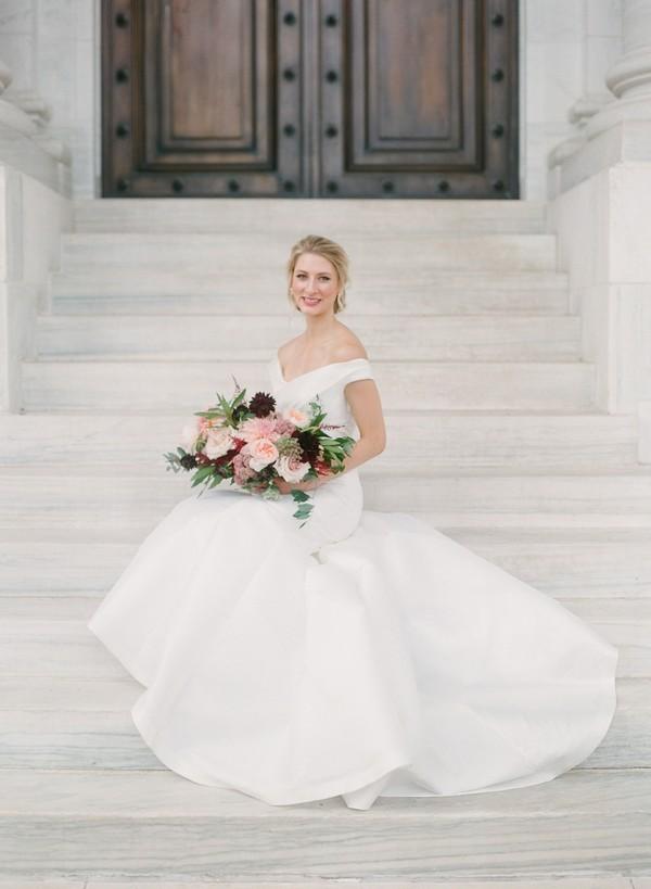 Bride sitting on steps of DAR, Washington