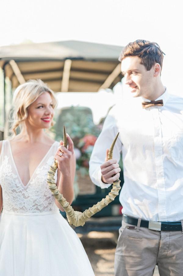 Bride and groom holding antlers