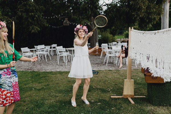 Bride-to-be playing badminton on hen party
