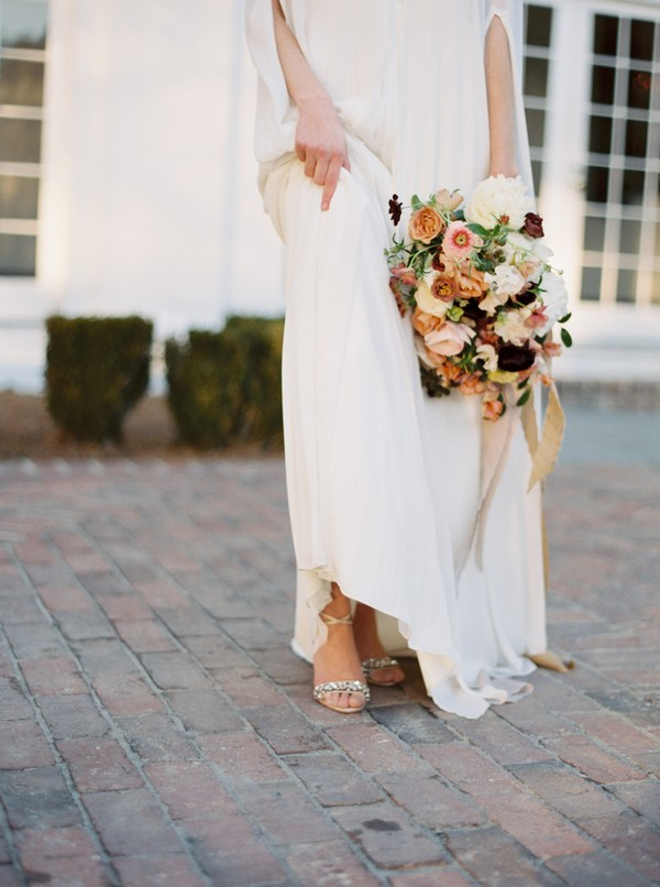 Bride pulling up dress to show shoes
