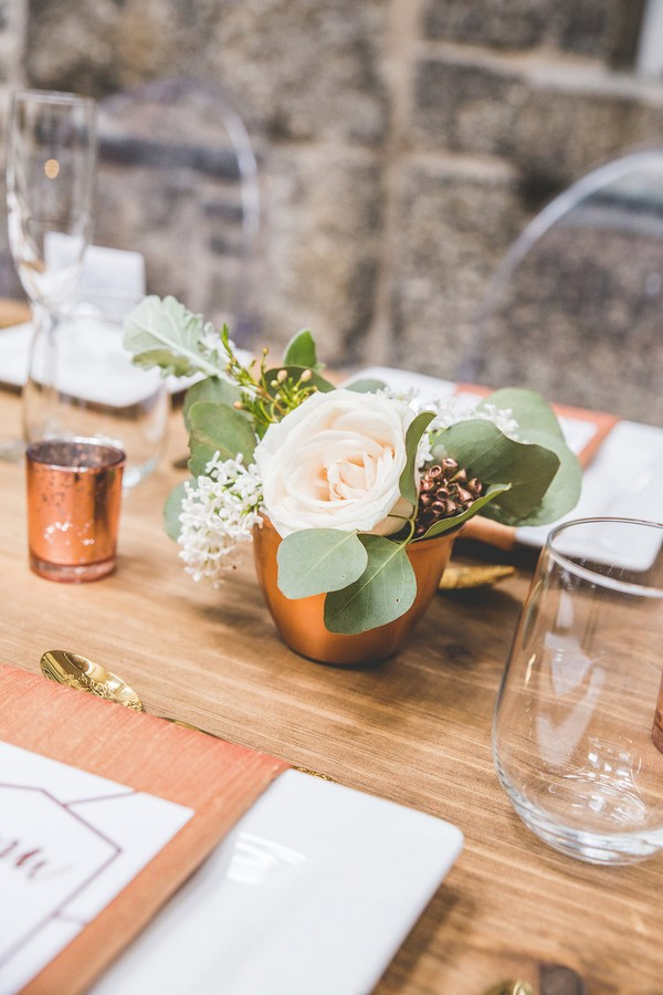 Wedding table flowers in copper pot