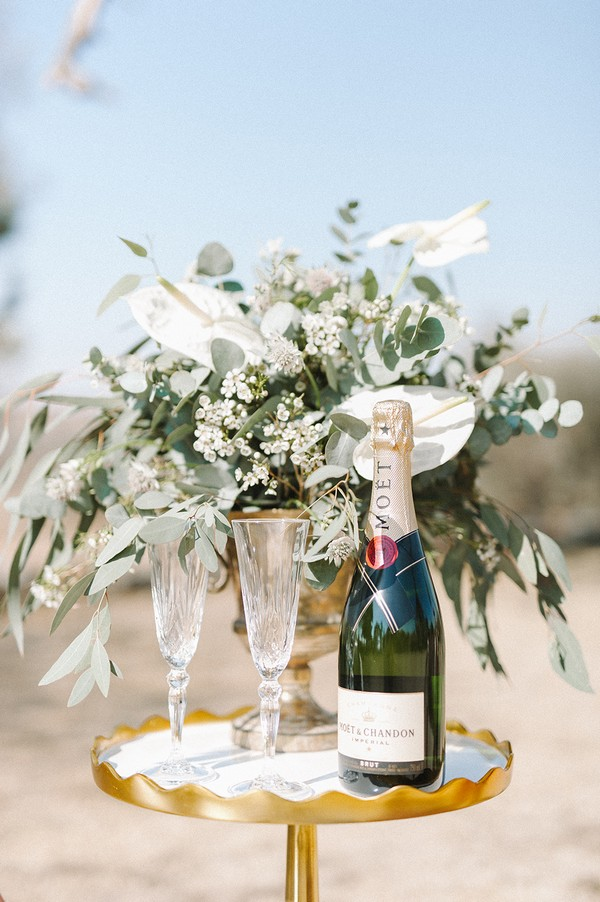 Bottle of Champagne on small wedding table