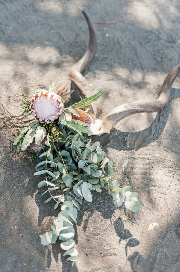 Bridal bouquet with large flower and lots of foliage on ground